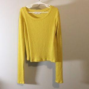 Mustard colored long sleeved crop top